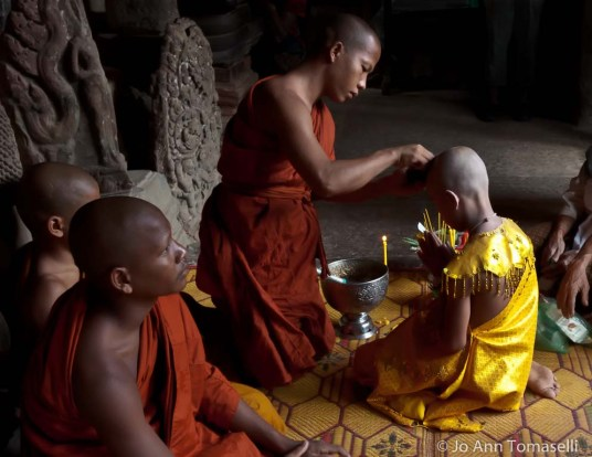 A young boys initiation into the Buddhist monk-hood ceremony at Angkor Wat Fine Art Travel Photography For-Sale online