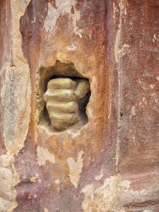 A clenched fist sculpture carved in sandstone.  Best buy image art online http://jo-ann-tomaselli.artistwebsites.com/featured/clenched-fist-cuban-image-art-jo-ann-tomaselli.html